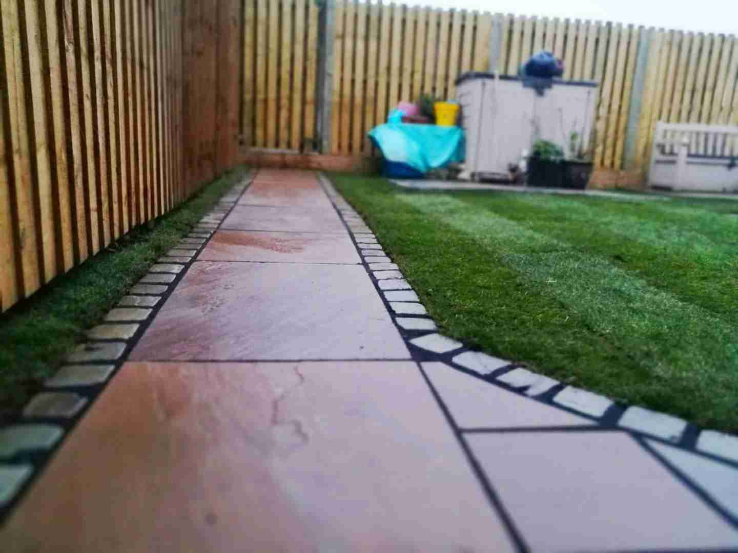 Indian stone paving with block stone boarders on a back garden landscaping job in Chorley, Lancashire