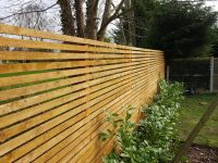 Custom built slatted fence