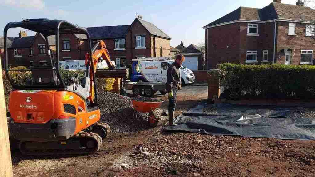 Clearing and levelling and area using a digger.