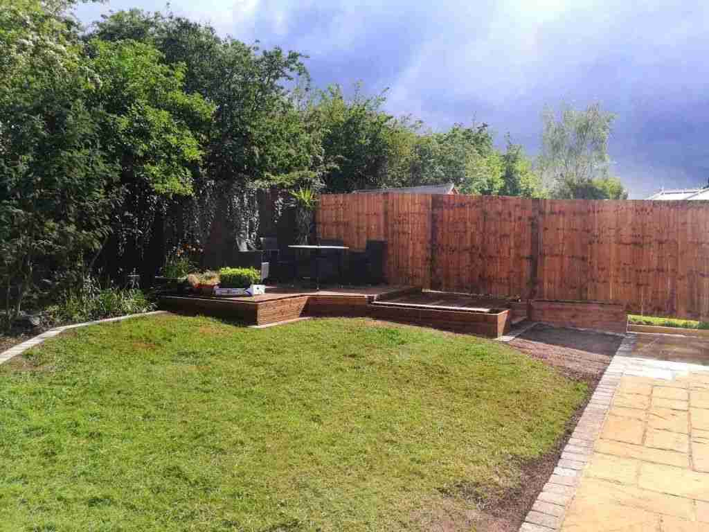 Wooden decking area with custom build wooden planters