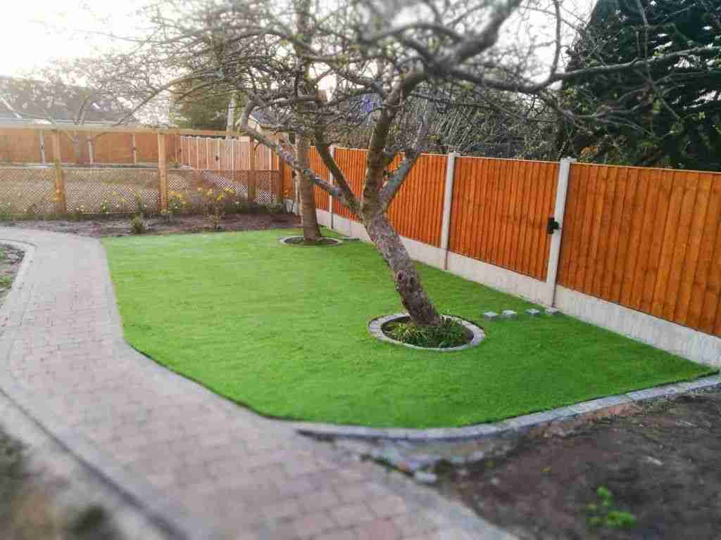 Artificial grass patch with trees in Much Hoole, Preston