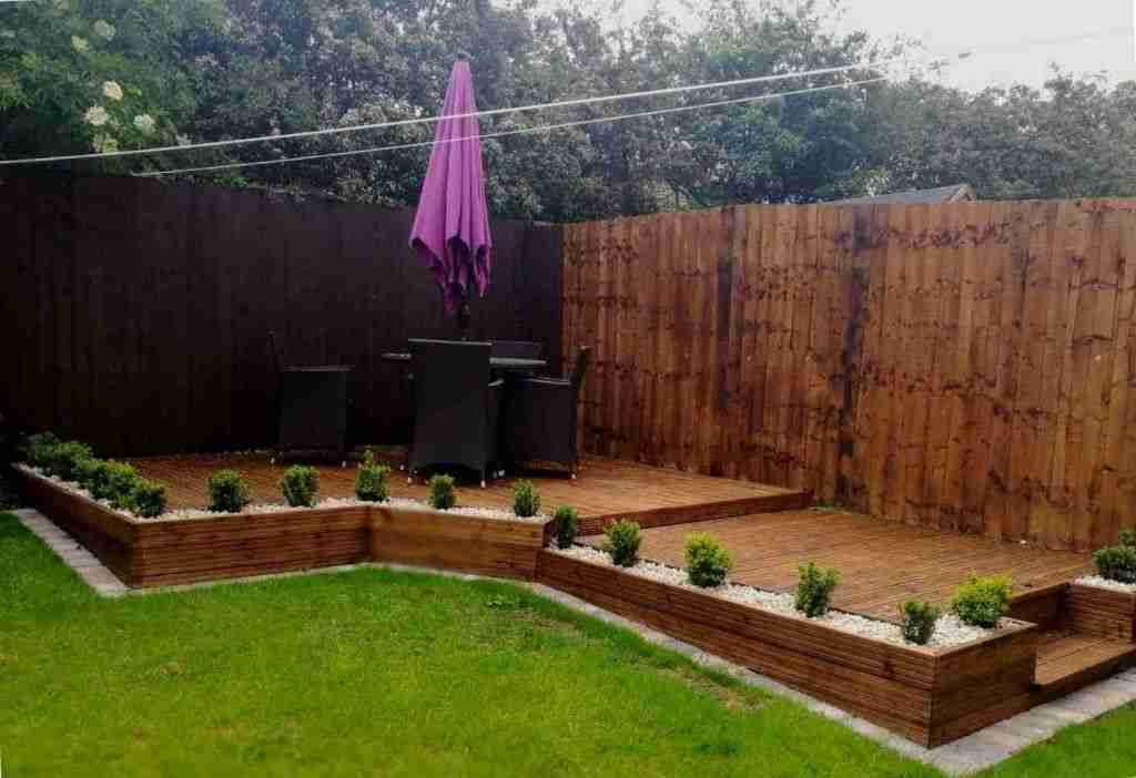 Raised hardwood decking with planters and shrubs