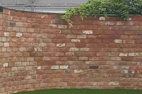 Burnt brick garden wall