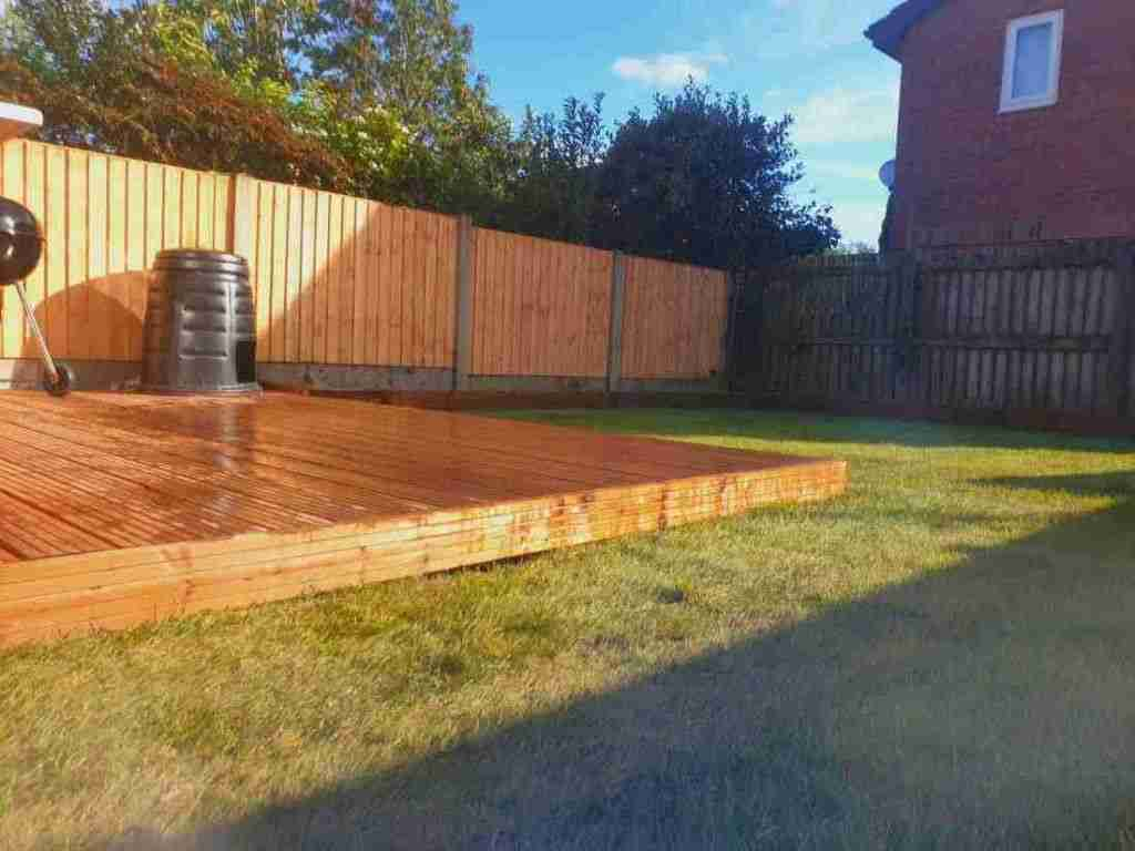 New landscape gardening work in Penwortham Preston. Showing soft wood decking area and a turfed lawn