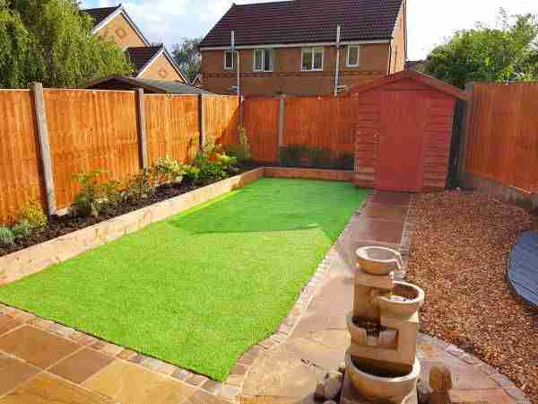 Installed artificial grass, Indian Stone paving, golden gravel, grey wooden decking. Full landscaping work