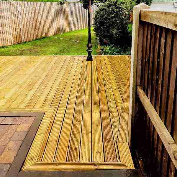 Wooden decking laid on soil/grass area