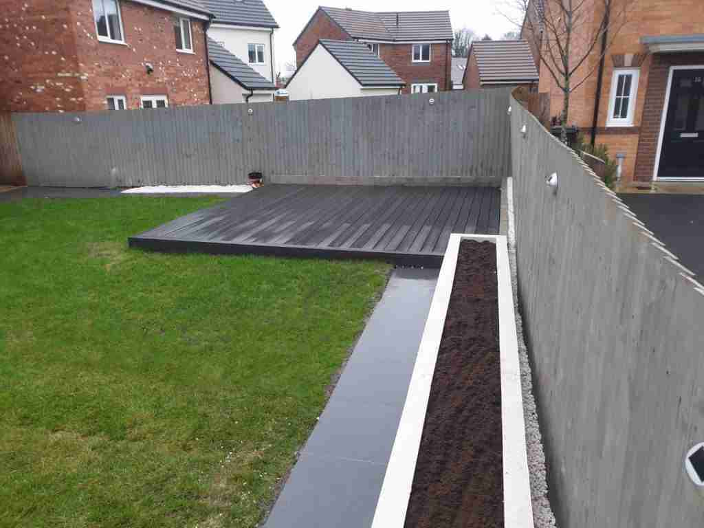 Grey composite decking and grey fence. Landscape gardening Preston