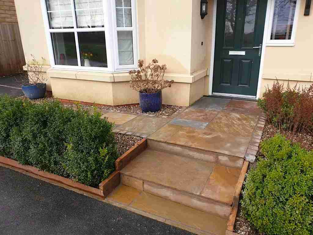Colourful Indian sandstone paving steps to front door
