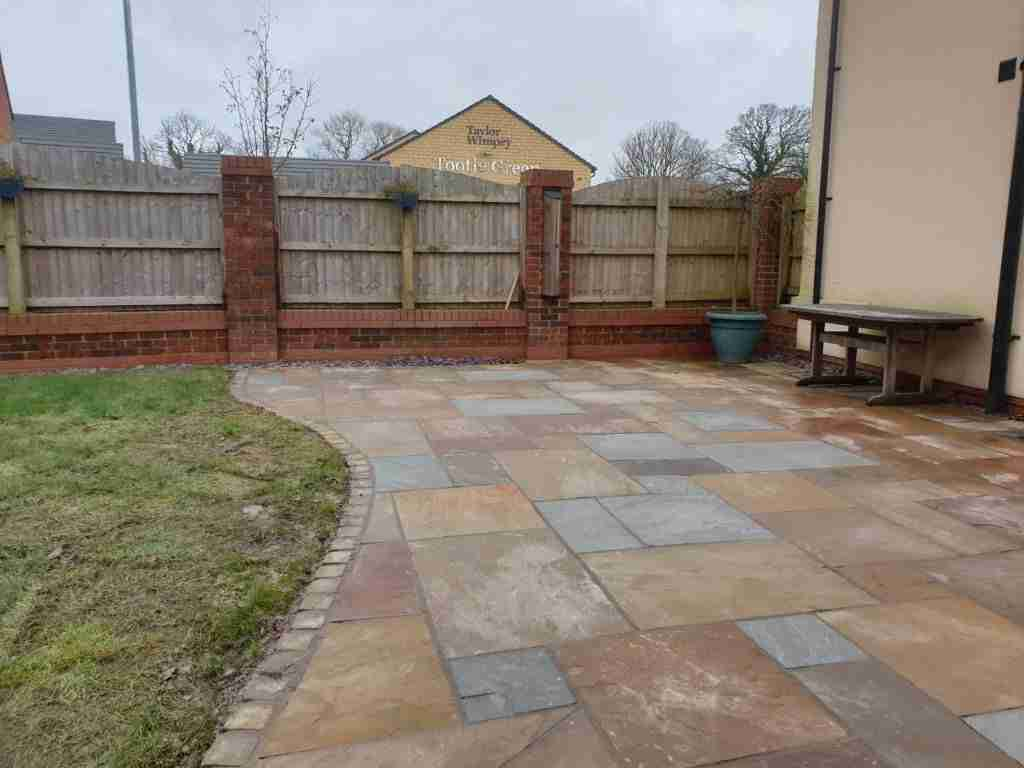 Waved natural stone patio edging