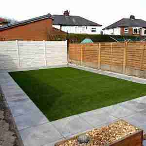 Landscaping work in Bamber bridge, Preston. light grey porcelain paving surrounding a rectangle of artificial grass