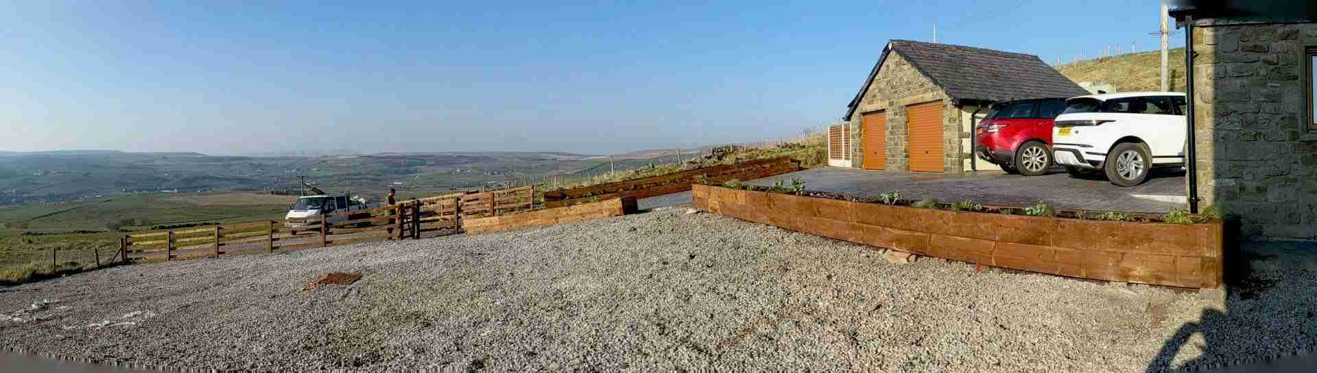 Landscaping work on converted farm. Showing new garden features including raised wooden planters and new fencing