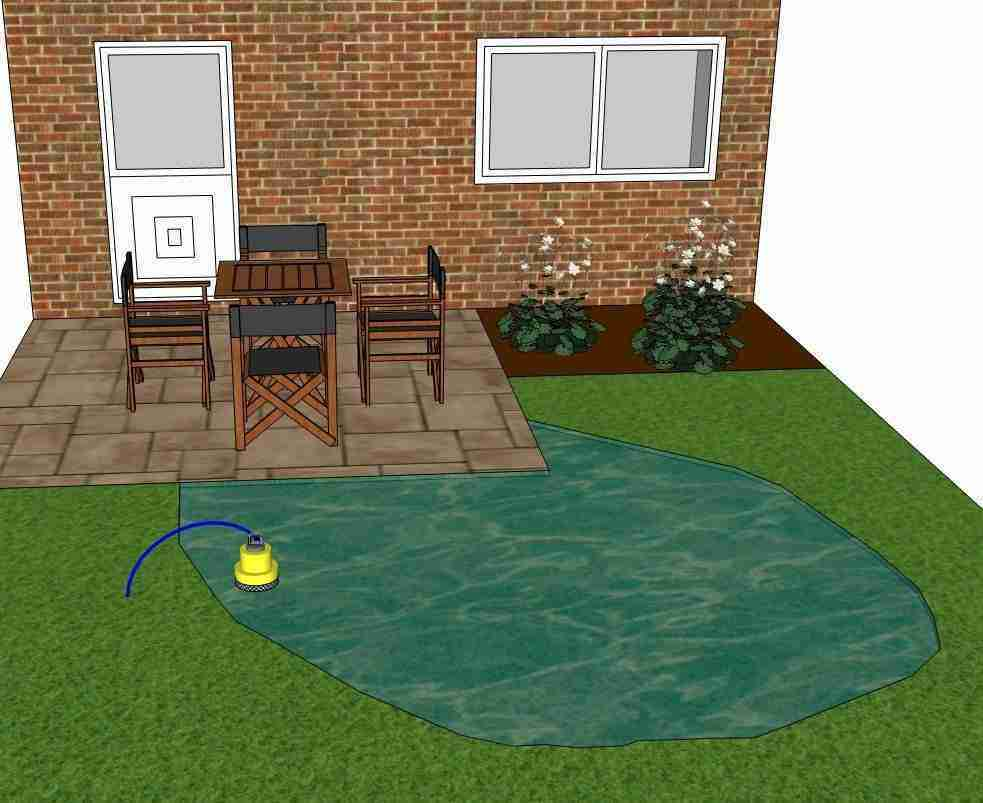 Image of puddle pump in pool of water on garden lawn