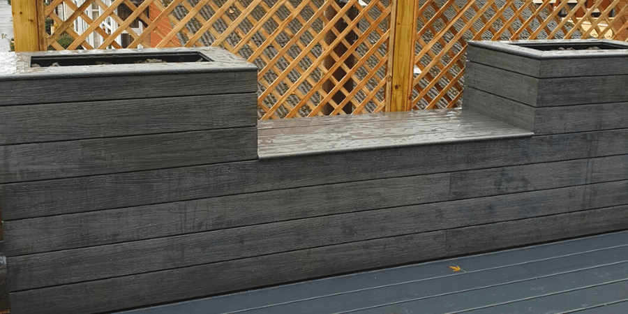 Composite seating and planters built with two types of soil grey decking boards
