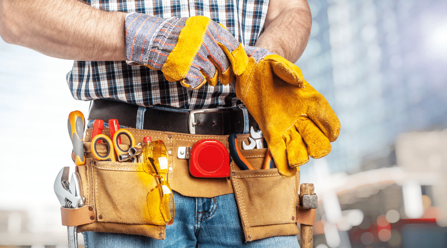 Man putting on builders gloves