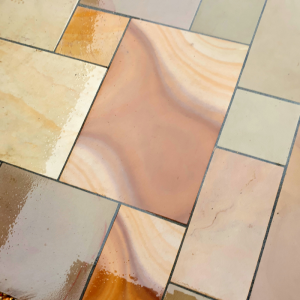 Close up of sandstone paving with minerals in it