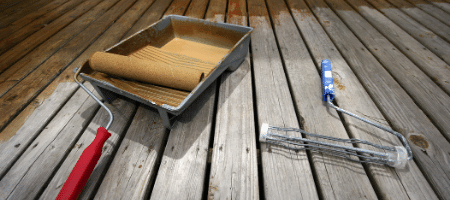 Applying non slip coating to decking to keep the moisture out