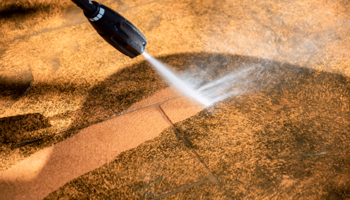 Pressure washed cleaning sandstone paving