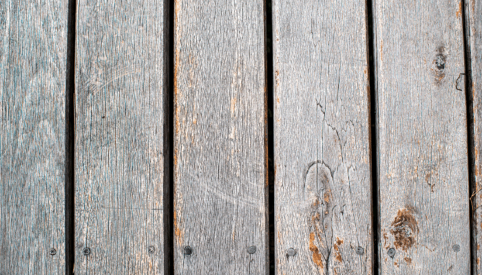 Weathered decking with rough texture and splinters