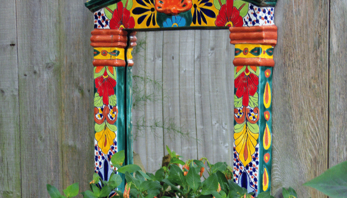 Colourful mirror in garden to enhance the perception of size
