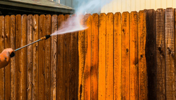 Jet washing a wooden fence