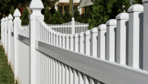 White picket fence with decorative tops