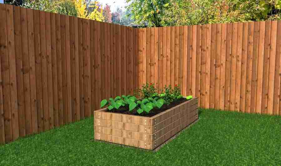 Raised planter with vegetables in it
