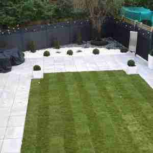composite fencing with white paving and turf