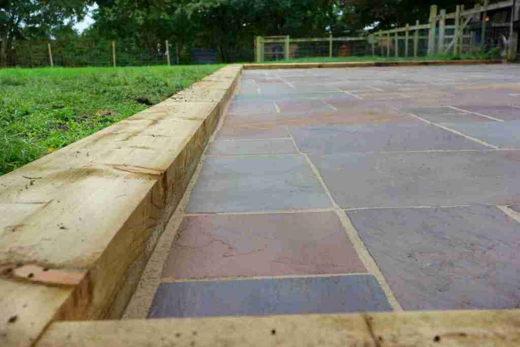 Wooden sleepers and resin sealed Indian stone paving