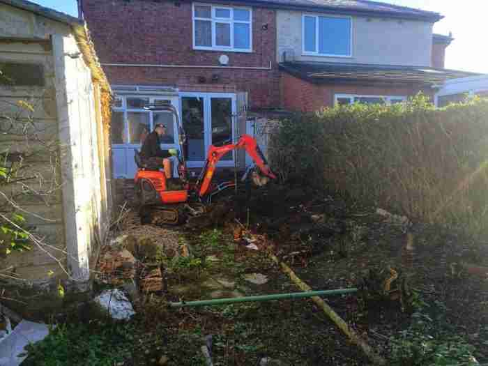 Excavating the ground ready to lay a patio in penwortham