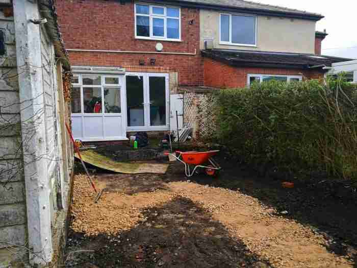 Laying the hardcore foundation for the paving in Penwortham