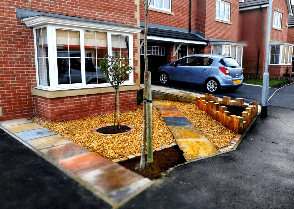 Small front garden with castle sleeper planters