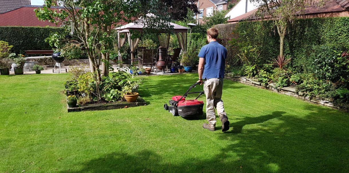Preston local gardeners cutting a nice lawn with a red lawn mower