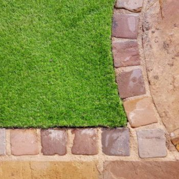 Artificial grass and block stone edging