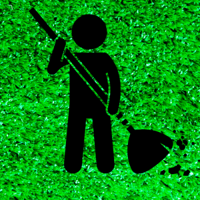 Sweeping artificial grass with a brush