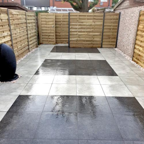 Porcelain paving with elite fencing garden design