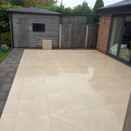 Porcelain paving and old garden shed