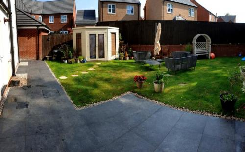 Garden conversion with porcelain paving