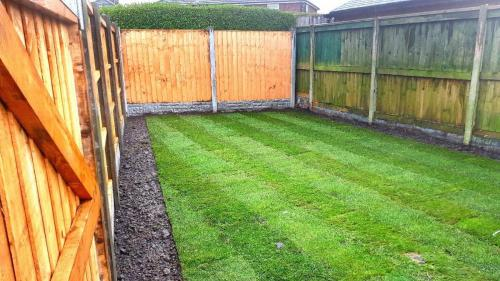 Rear fence and turf at landscaping job in Leyland,.