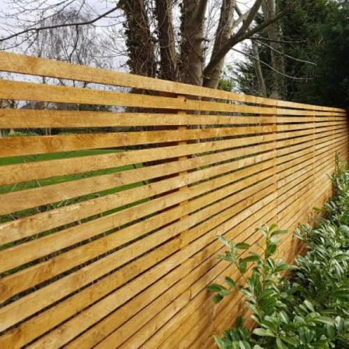 Custom build slatted wooden fence