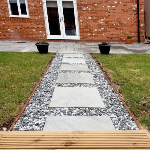 Sandstone stepping stone path with speckled gravel