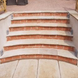 Red brick and white stone steps with rendered walls