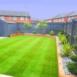 Bright striped artificial grass in a modern garden